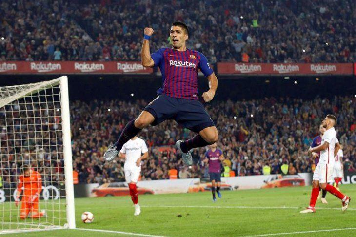 Luis Suárez celebra el gol ante Sevilla.
