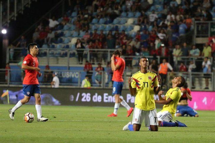 Jugadores de Colombia celebran la victoria ante Chile.