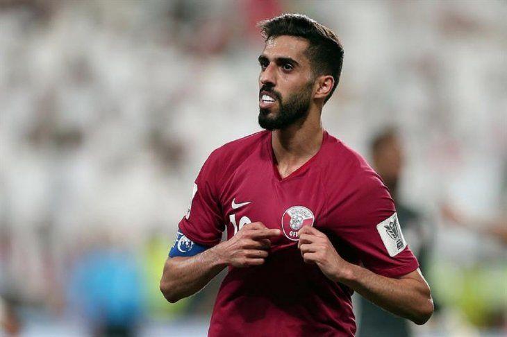 Hassan Al-Haidos celebra tras marcar el 3-0 durante el partido contra EAU.