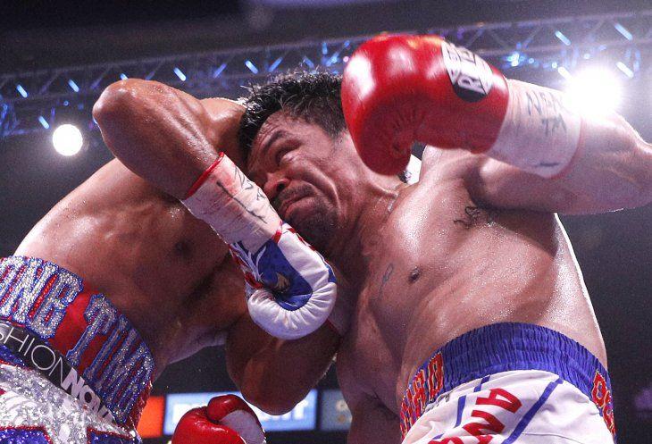 Pacquiao venció en fallo dividido a Thurman.